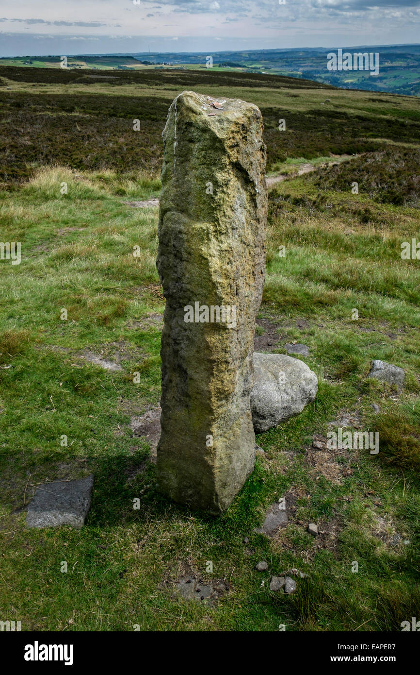 Standing stone Churn Milk Joan on the Calderdale Way with coins left by visitors. Yorkshire Stock Photo