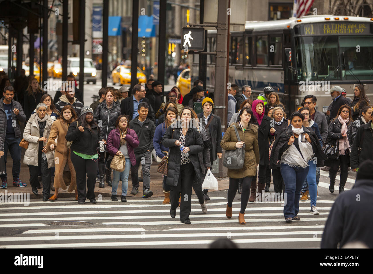 5th Ave. at 42nd Street is one of the most constantly crowded corners in New York City. Stock Photo