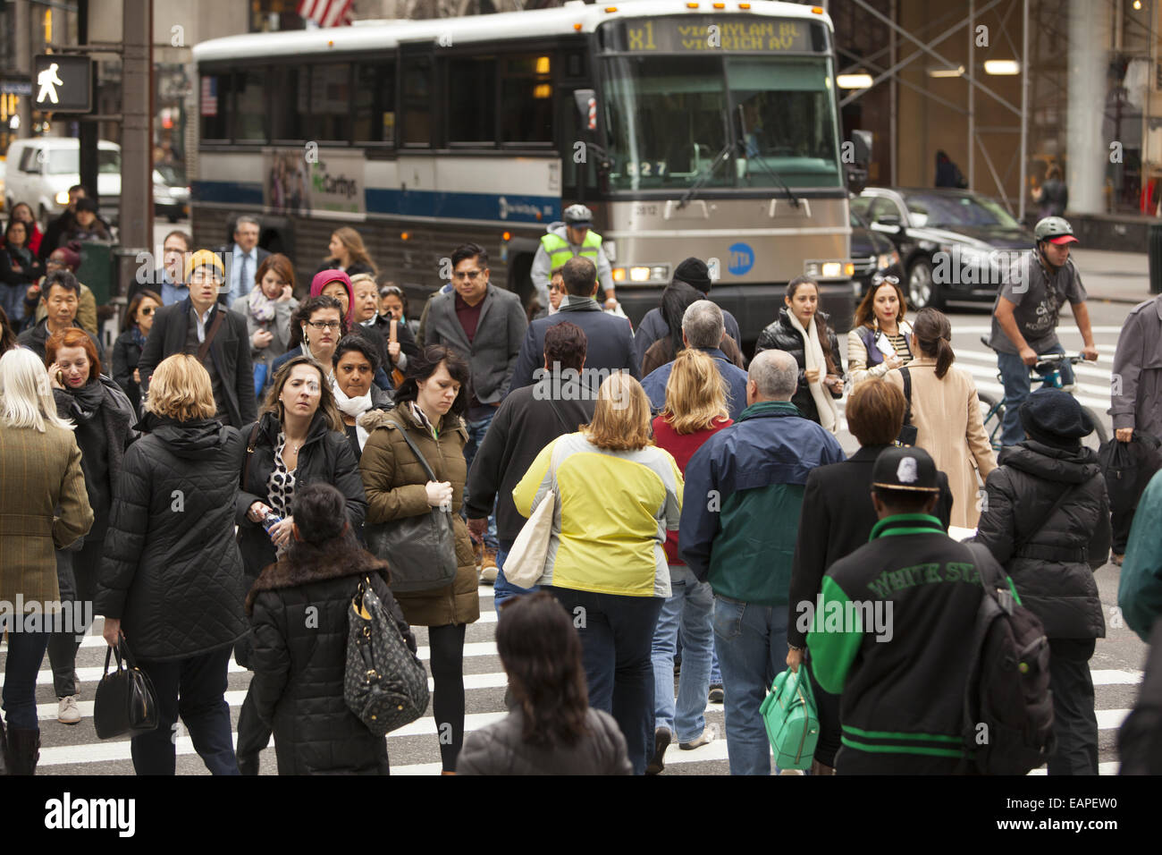 5th Ave. at 42nd Street is one of the most constantly crowded corners in New York City. - Stock Image