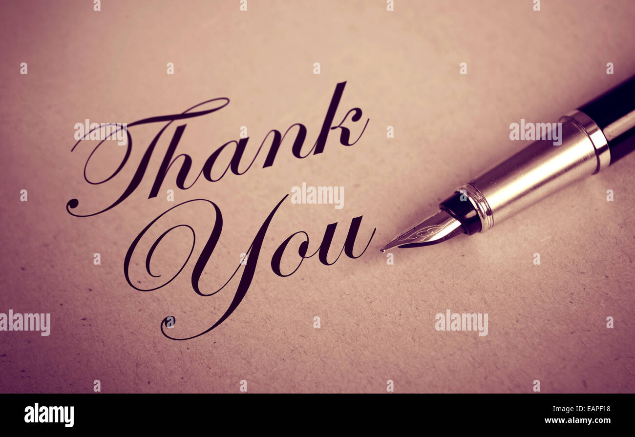 Fountain Pen and Thank You message on old paper textured background - Stock Image