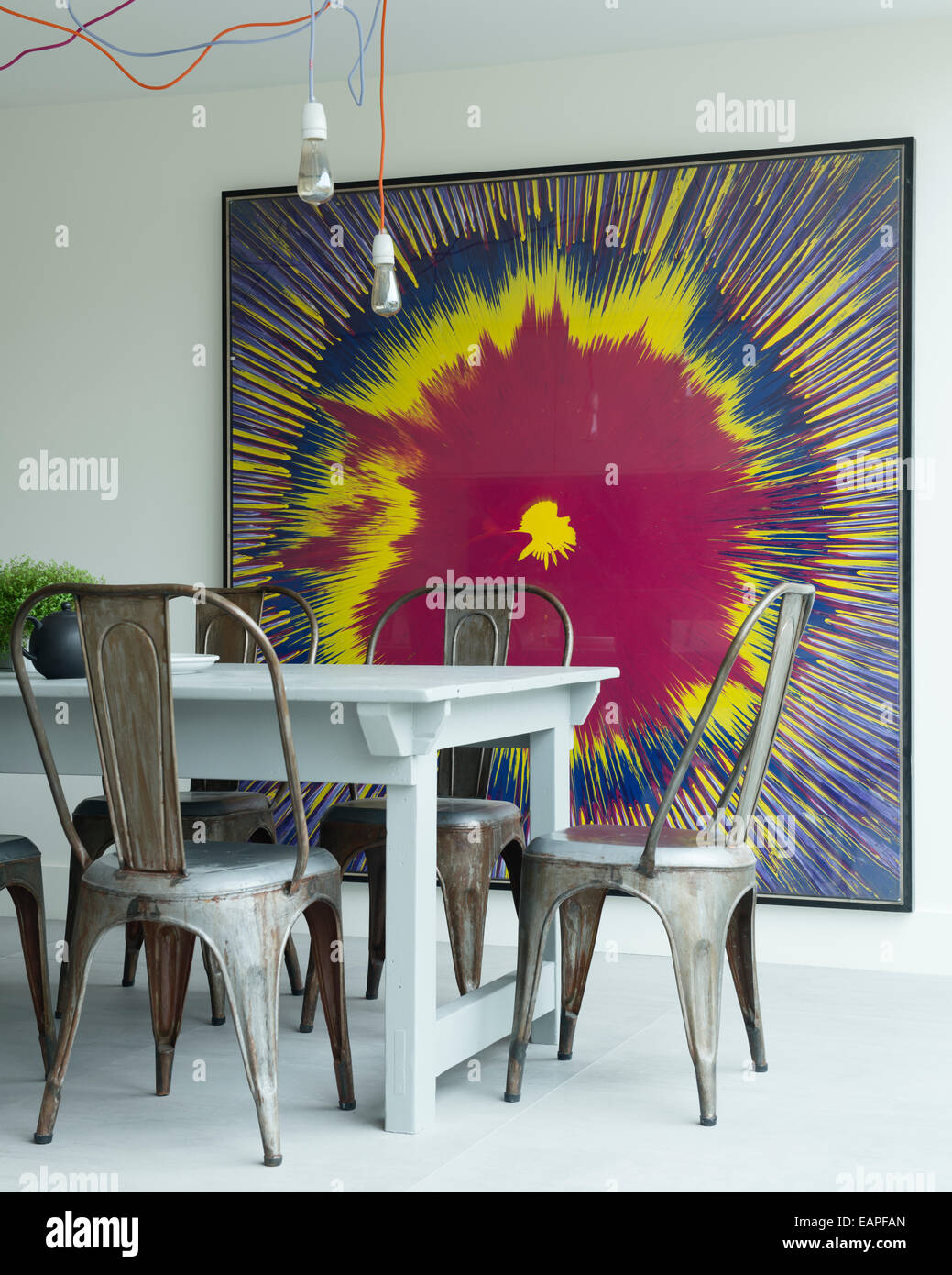 Tolix Steel Chairs Around Wooden Farmhouse Table In Modern Kitchen With  Andy Shaw Artwork And Textile Cable Pendant Ceiling Ligh
