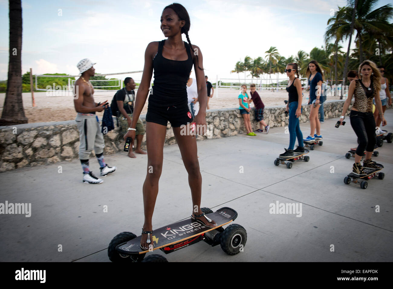 Women on motorised skateboards. Miami Beach, Florida Stock ...