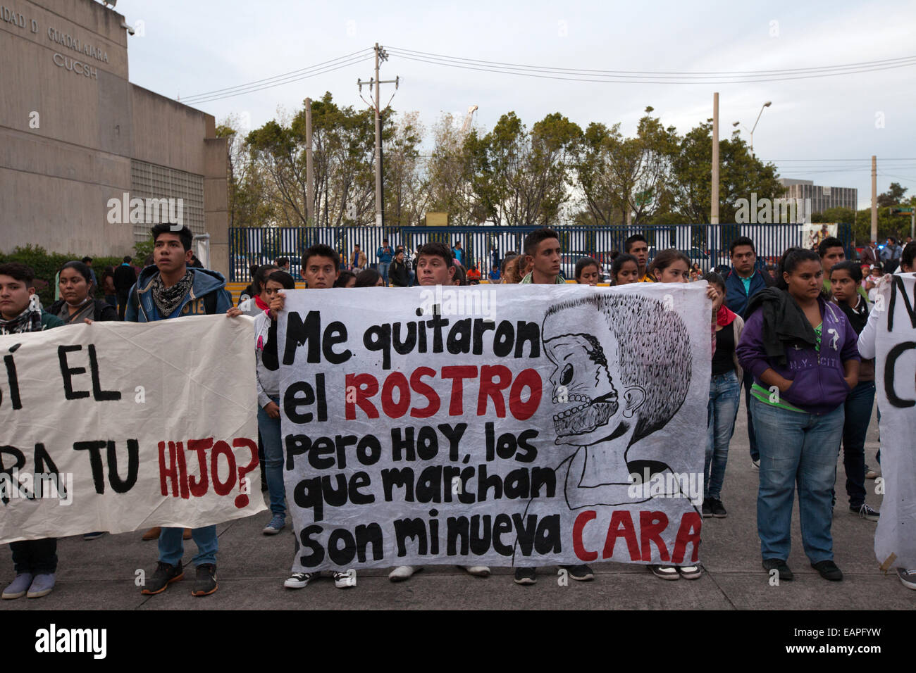 """NormalSchoolstudents from the Atequiza's teacher-trainingcollege """"Miguel Hidalgo"""" hold placards during a performance Stock Photo"""