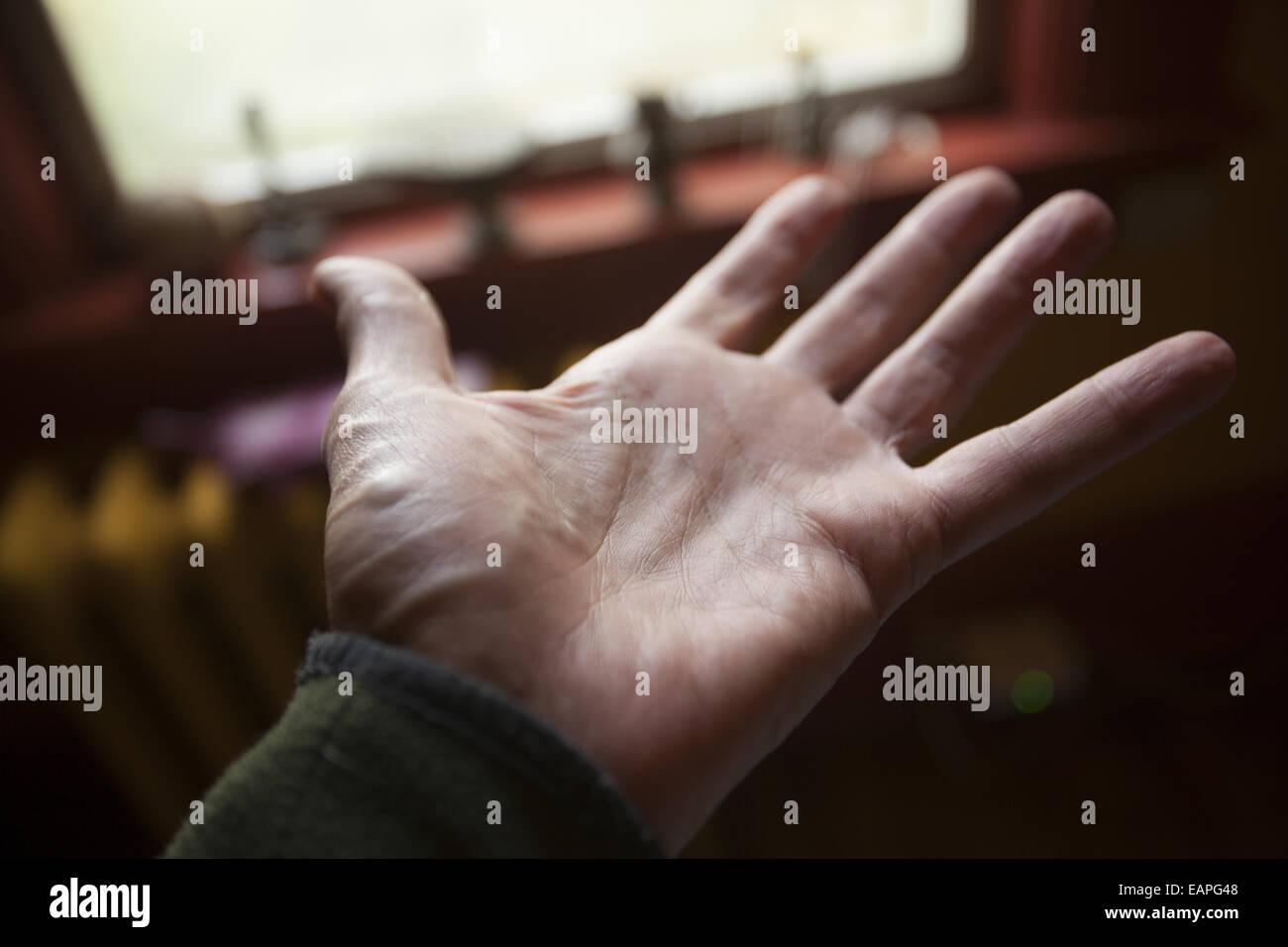Man's open left hand. - Stock Image