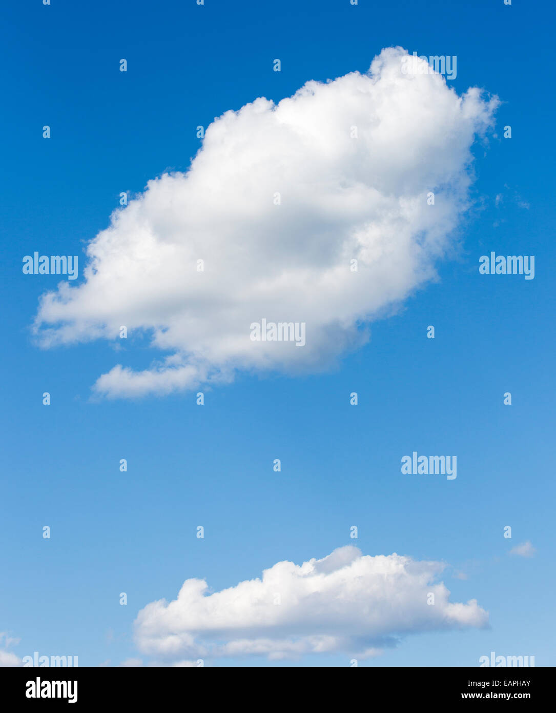 Two white clouds on blue sky - Stock Image