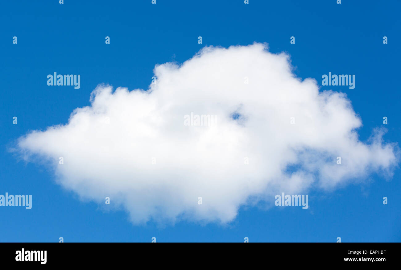 One white cloud on blue sky - Stock Image