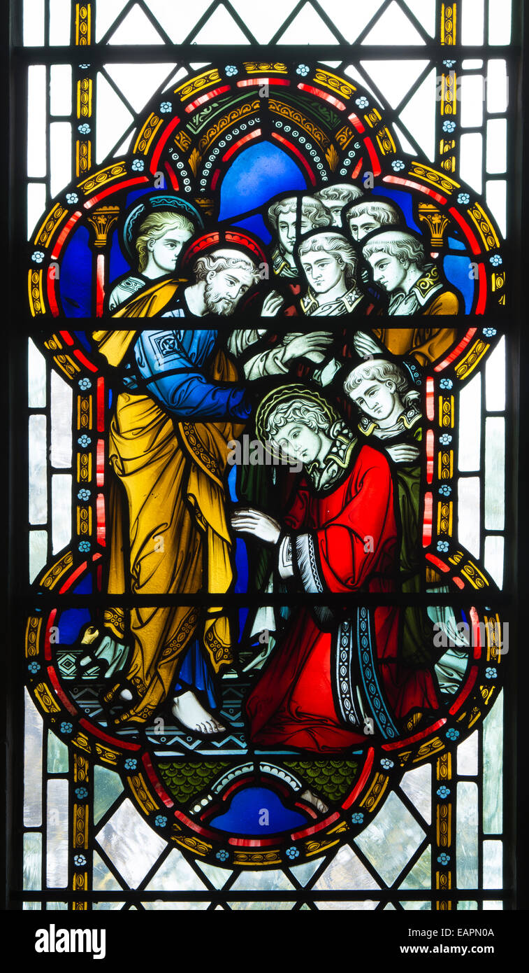 Ordination of Saint Stephen stained glass by Hardman in St. John`s Chapel, Worcester Cathedral, UK - Stock Image
