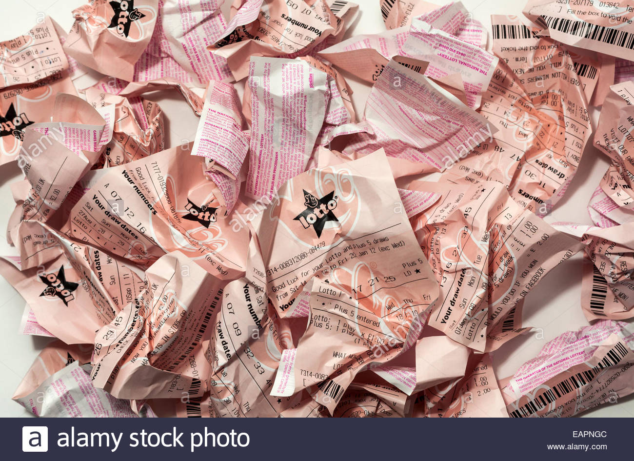 Scrunched up lottery tickets - Stock Image