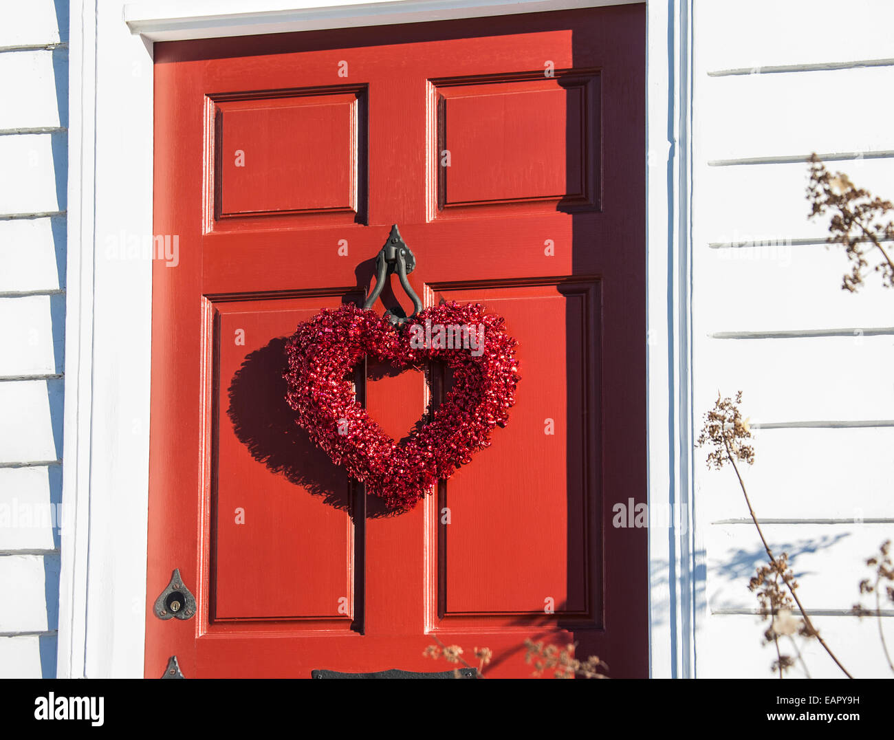 Red Front Door With A Red Heart Wreath For Saint Valentines Day