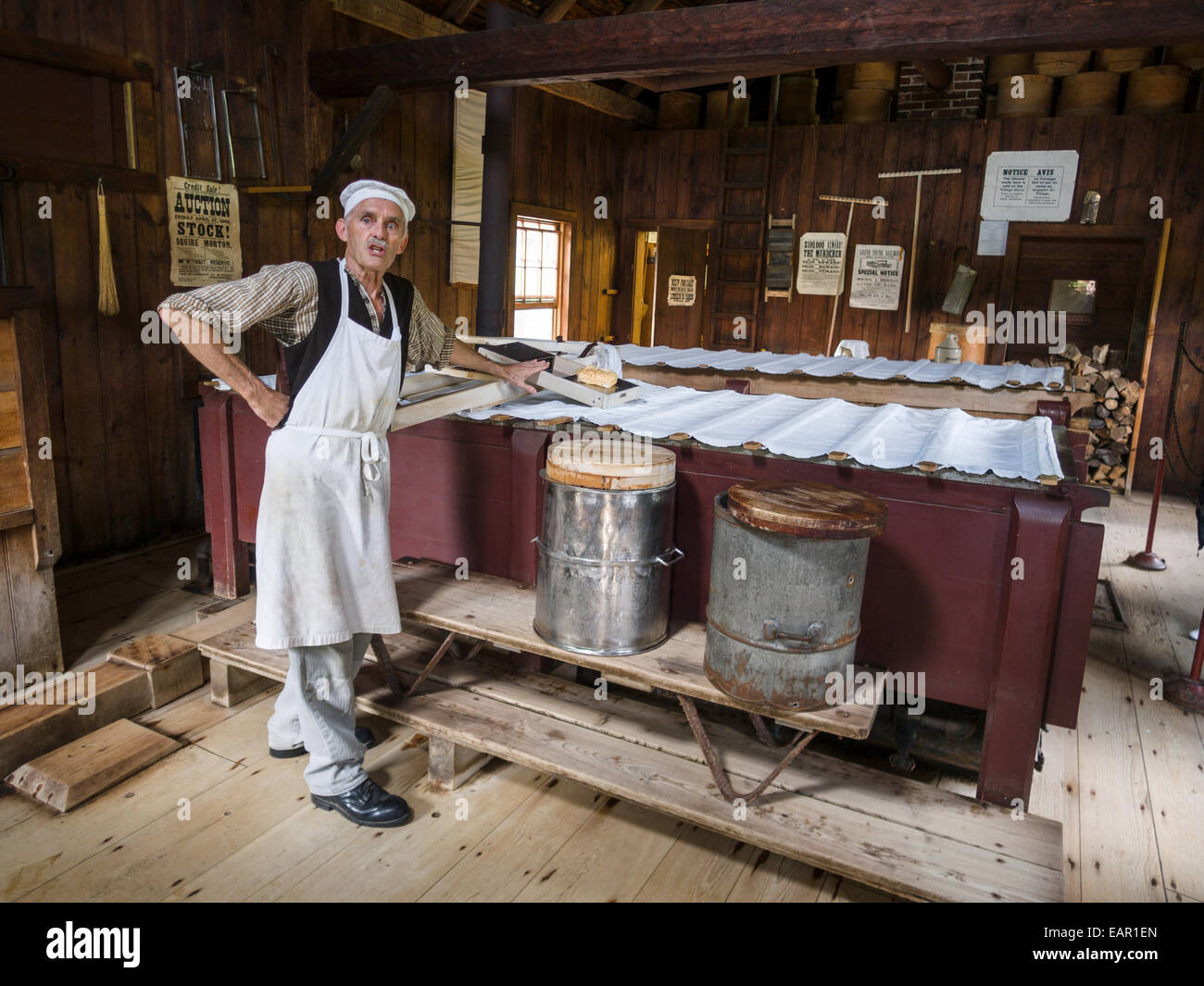 Upper Canada Village Cheese maker. The Village cheese maker explains the process while today's batch 'cooks' - Stock Image