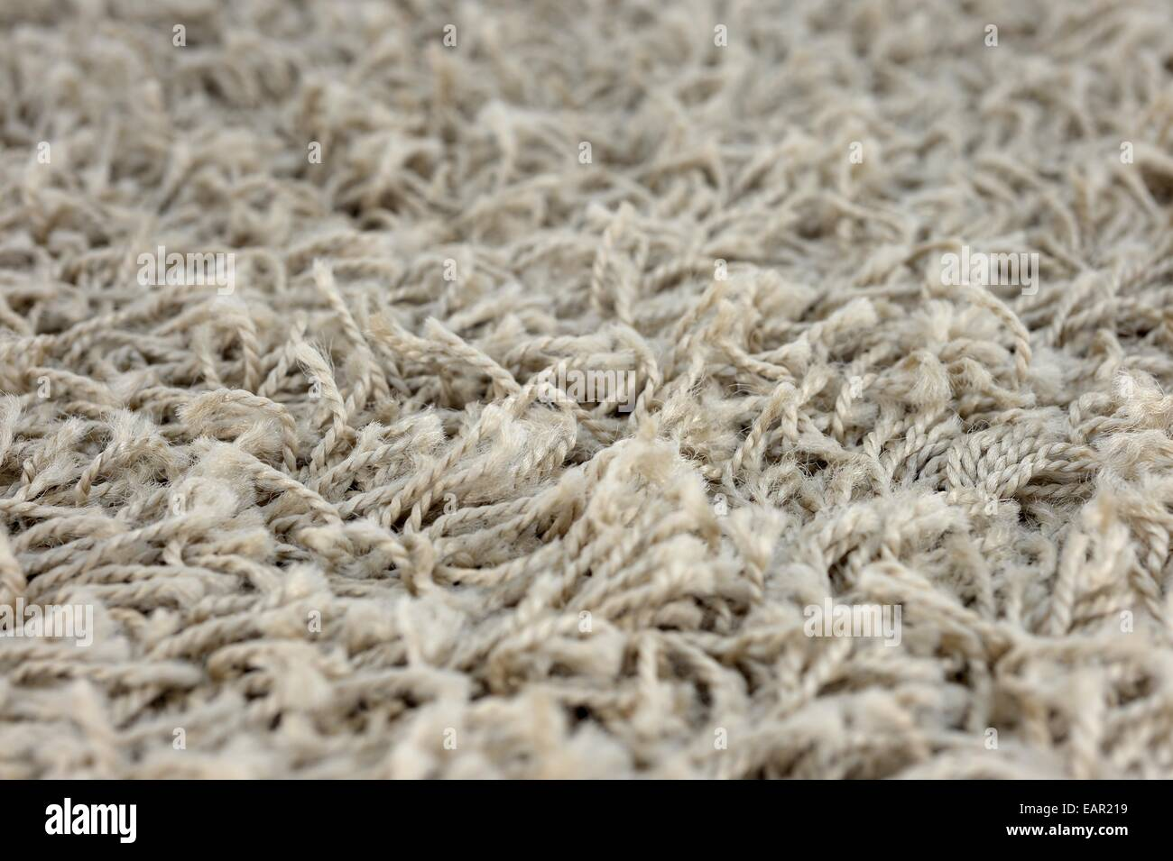 A close up shot of shag carpet - Stock Image