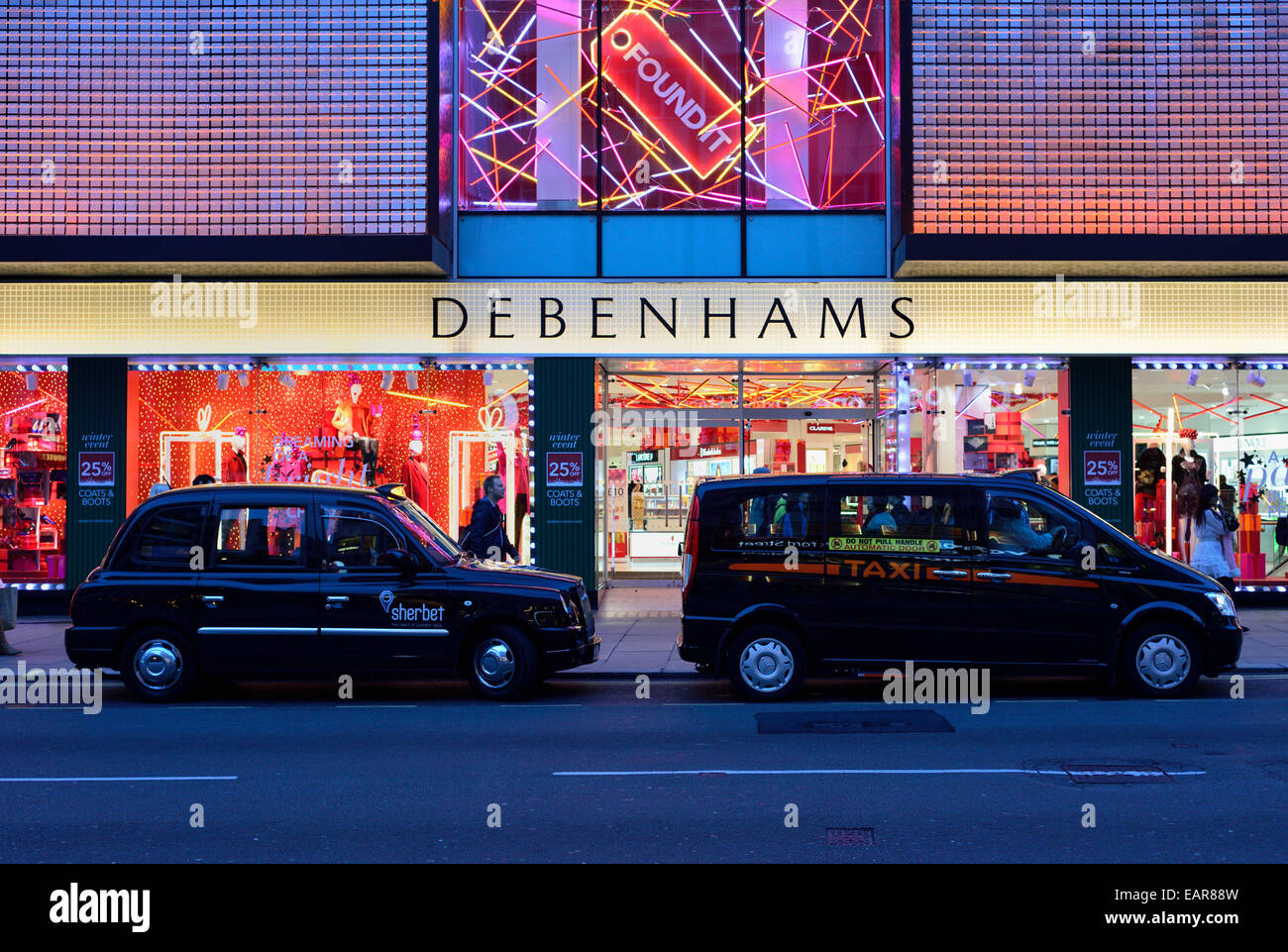 Taxis outside store, Oxford Street, London, United Kingdom - Stock Image