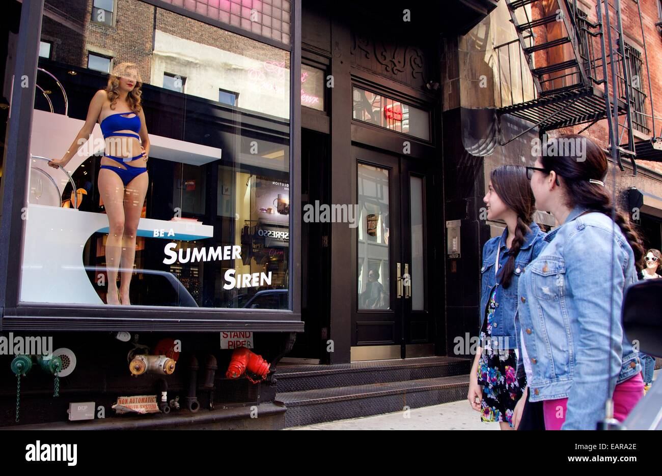 A live model poses in the window at the Agent Provocateur Store in Soho 54e783fe7