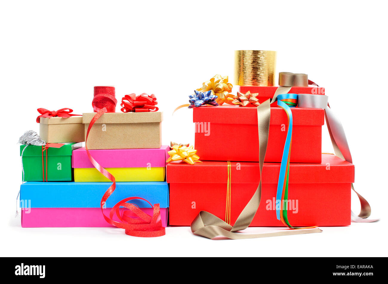 a pile of different boxes, ribbon and ribbon bows of different colors to prepare gifts, on a white background - Stock Image