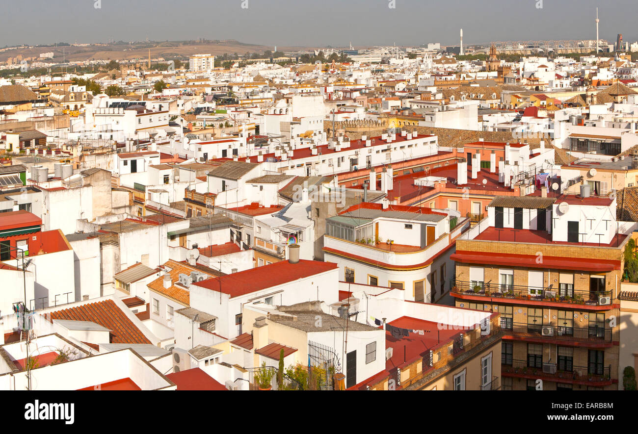 Cityscape view over rooftops in barrio Macarena, Seville, Spain - Stock Image