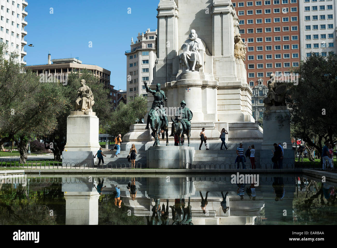 Don Quixote statue at Spain Square in Madrid full of tourists - Stock Image