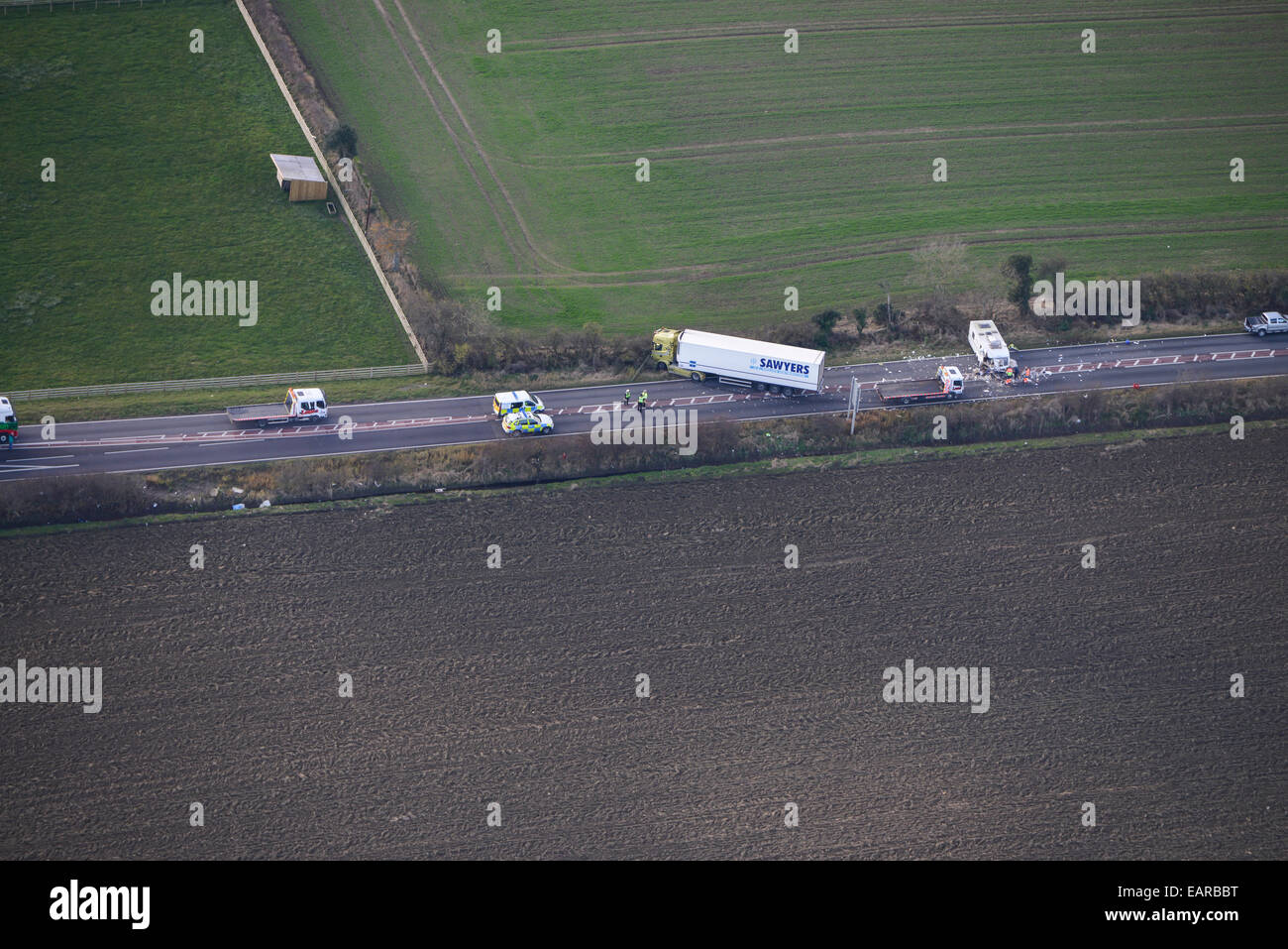 An aerial view of a road accident involving a caravan and an HGV - Stock Image