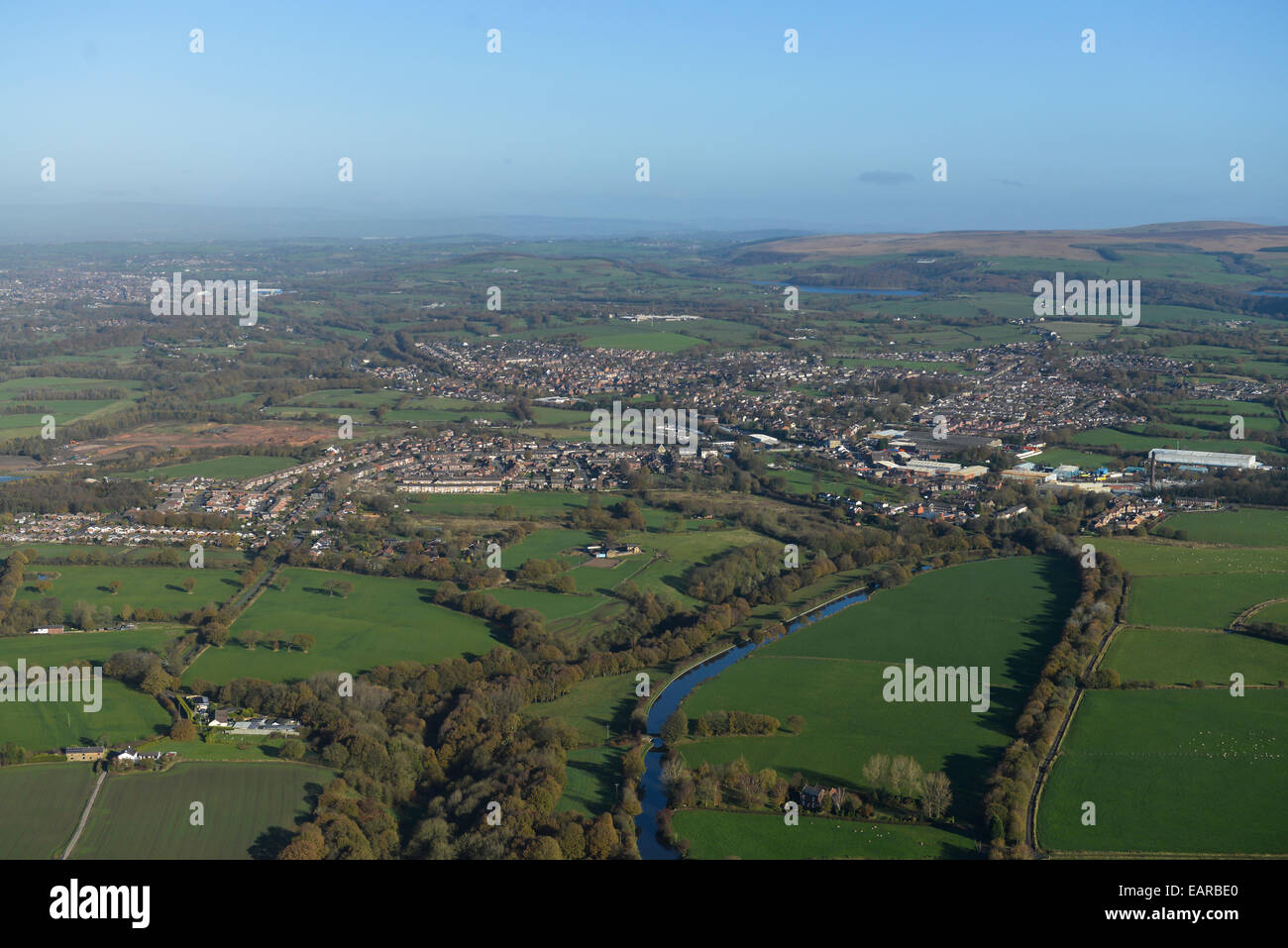 An aerial view of the Lancashire countryside looking toward the West Pennine Moors with the town of Adlington visible - Stock Image