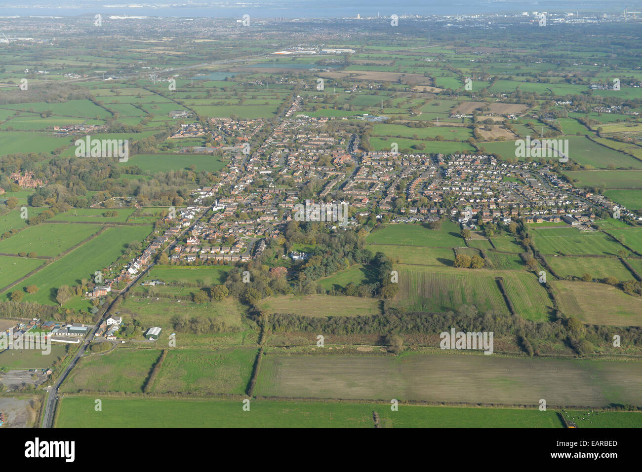 An aerial view of the Cheshire village of Saughall and surrounding countryside - Stock Image