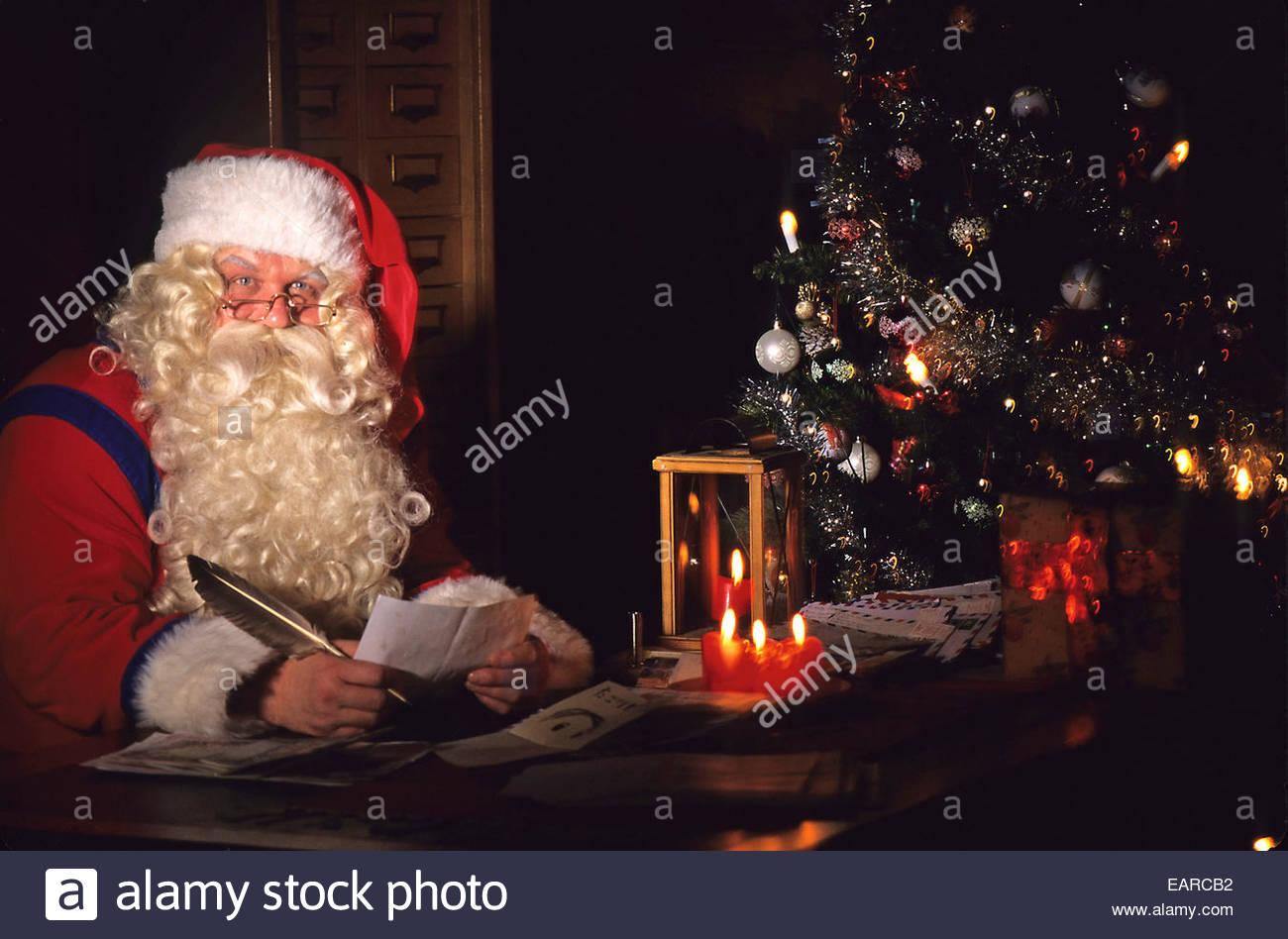 Santa Claus reading a letter, Rovaniemi, Finland. - Stock Image