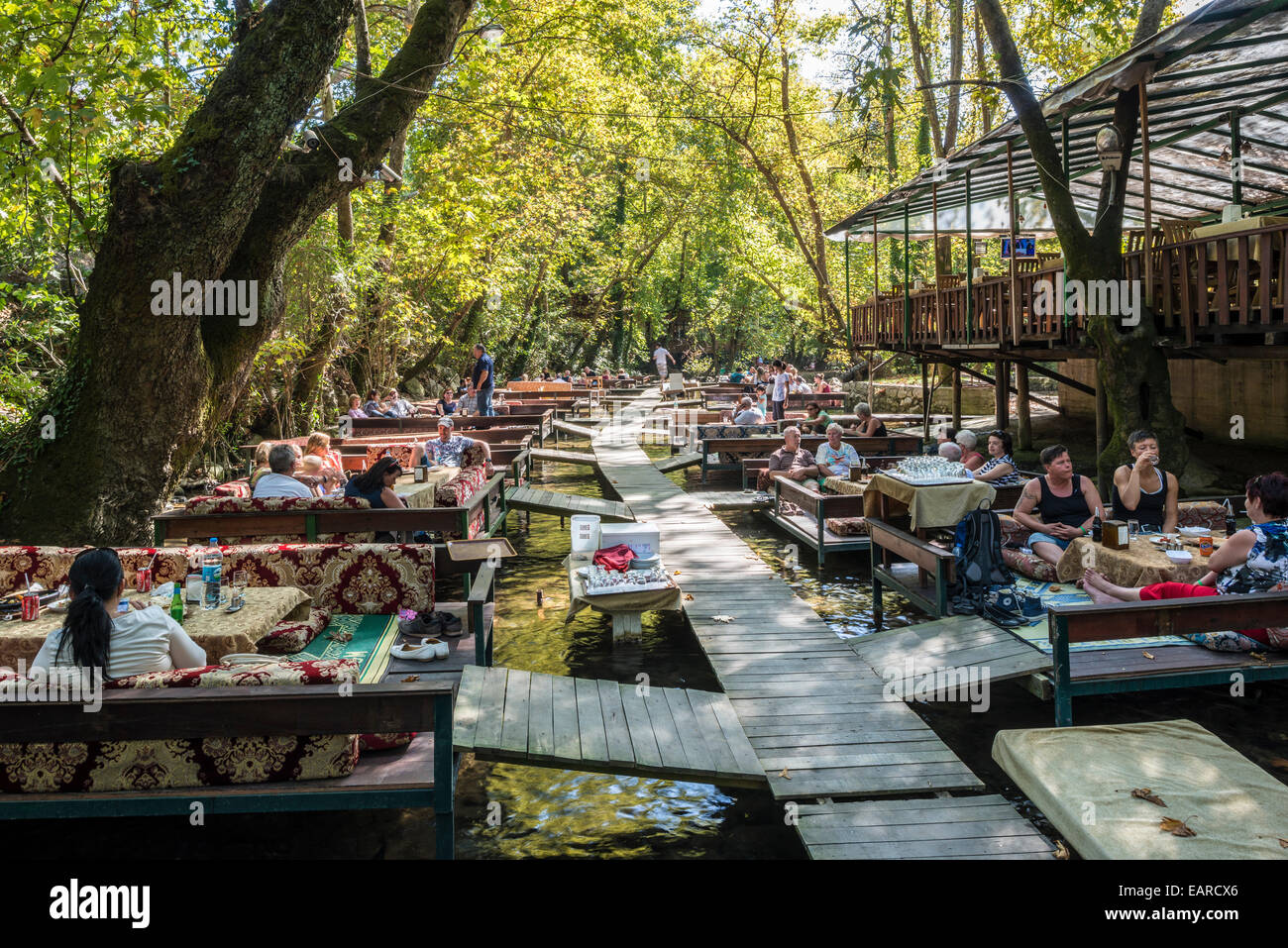 BOTANIK fish festaurant in coastal forest, seating above the trout waters, Ulupınar, Antalya Province, Turkey - Stock Image
