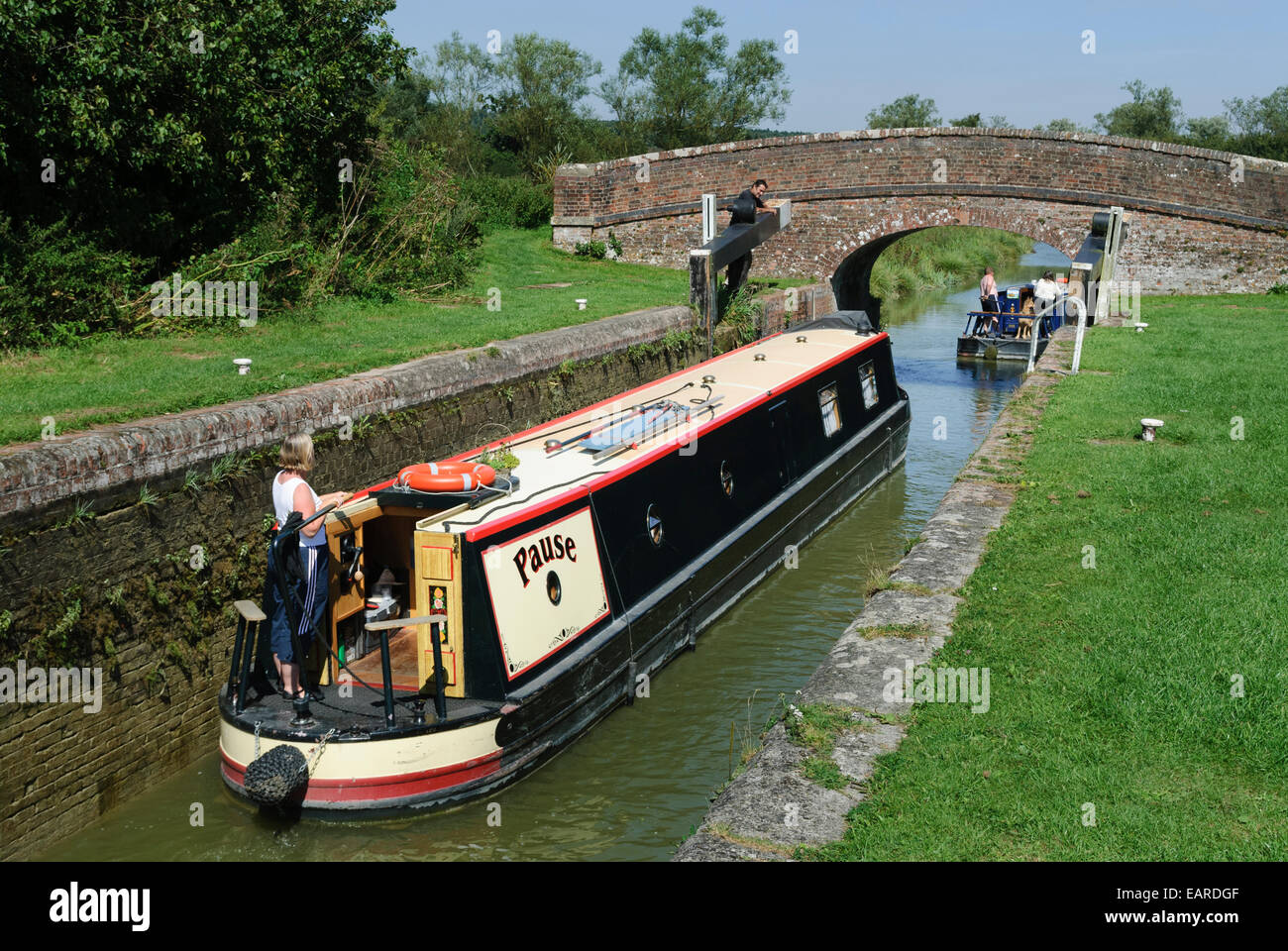 two narrow boats going through lock 68 together west of Hungerford - Stock Image