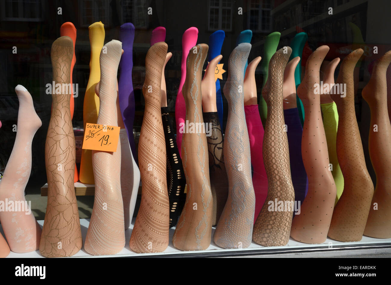 Display of mannekins' legs with stockings or tights in a shop window, Gdansk, Pomeranian Voivodeship, Poland - Stock Image