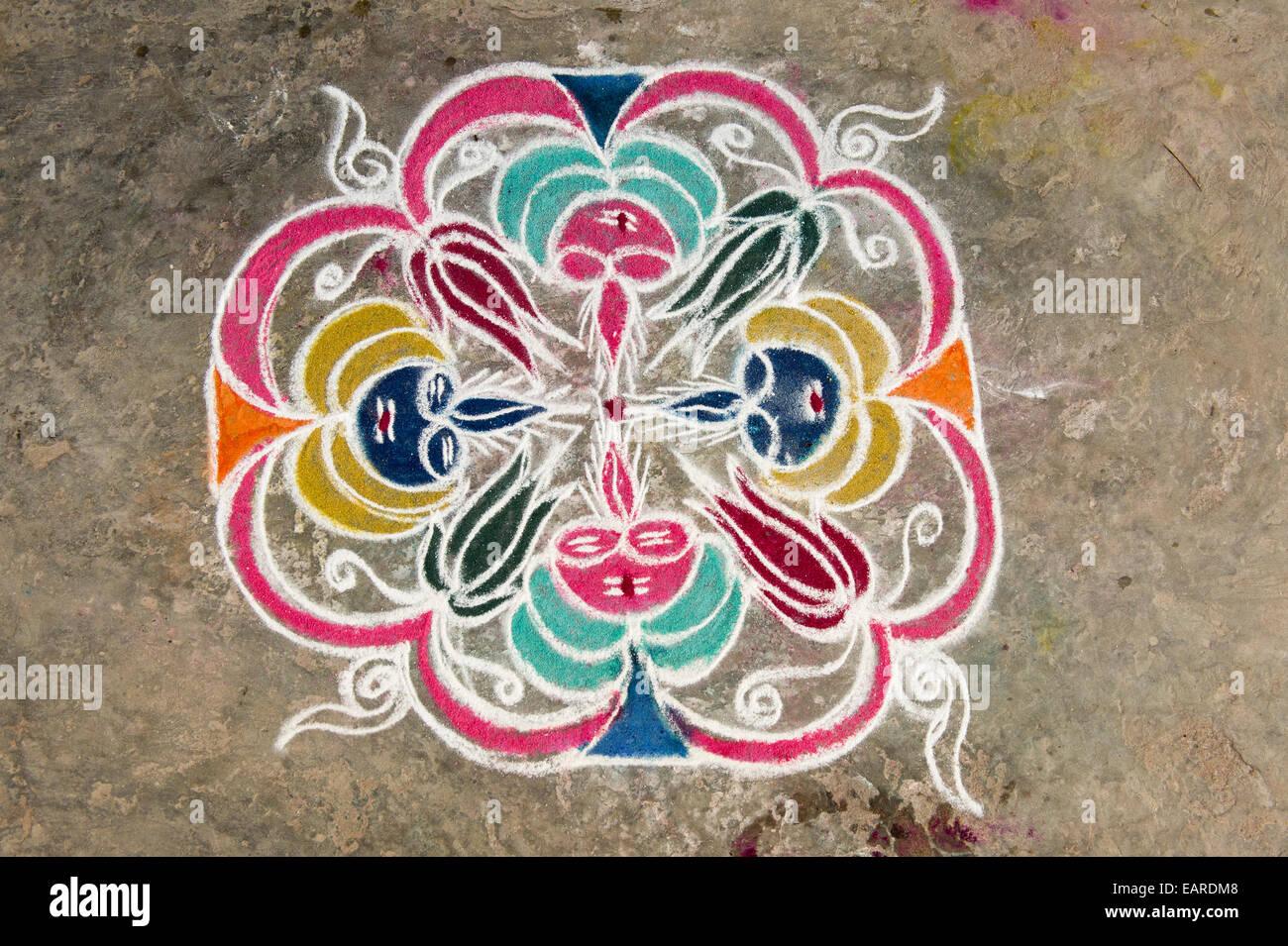 Traditional Rangoli, Kolam or Muggu, decorative pattern made of coloured sand, Rameswaram, Pamban Island, Tamil - Stock Image