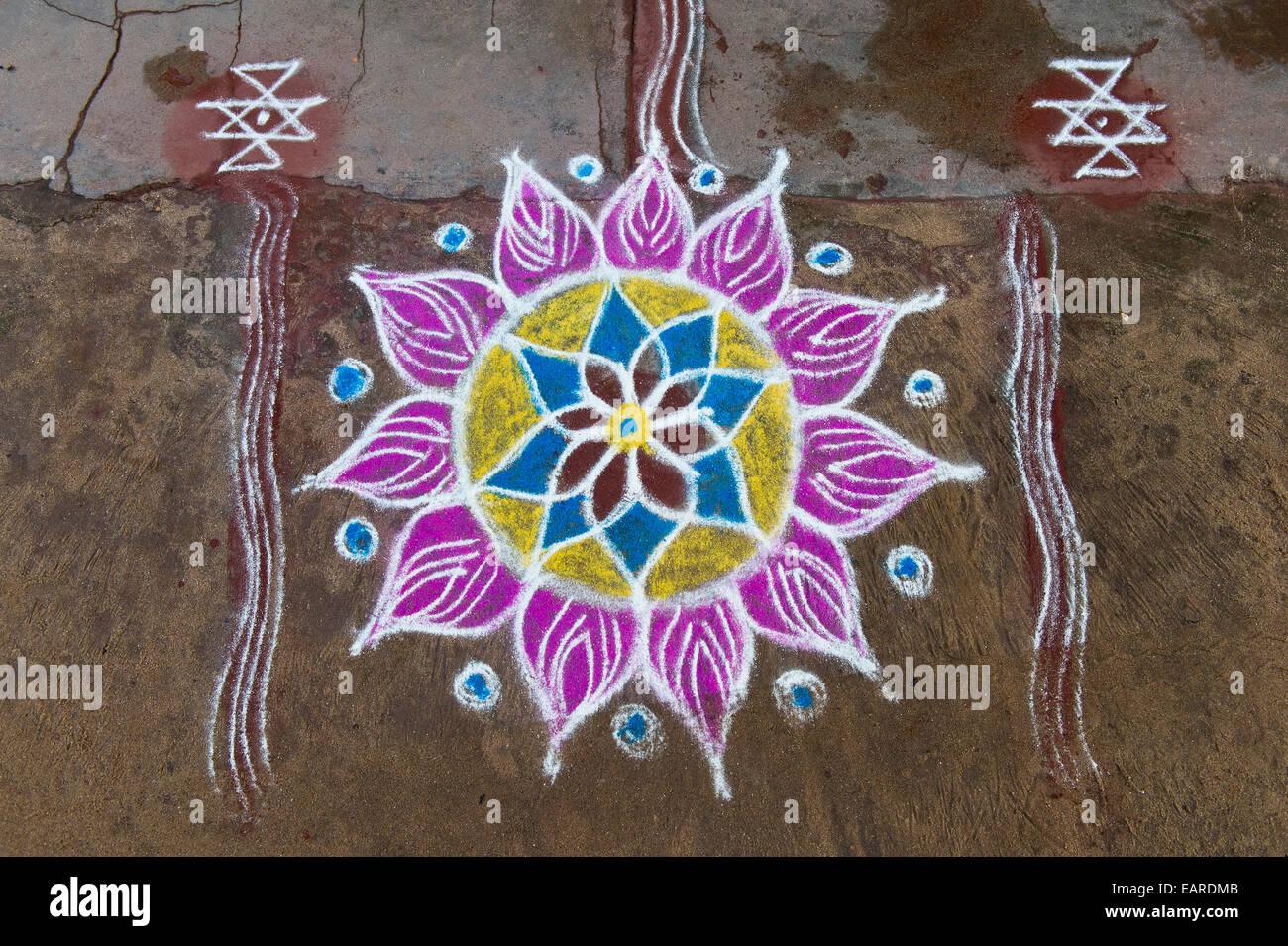 Traditional Rangoli, Kolam or Muggu, decorative pattern made of coloured sand, Rameswaram, Pamban Island, Tamil Stock Photo