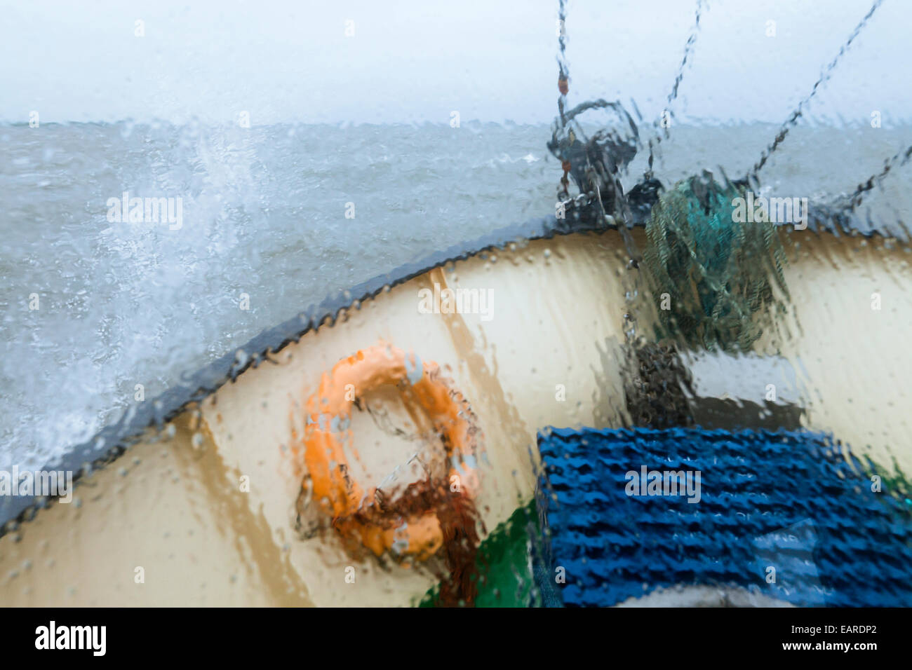 """View through the wet window of the bow of the shrimp boat """"Columbus"""" from Pellworm island, travelling in North Frisian Stock Photo"""