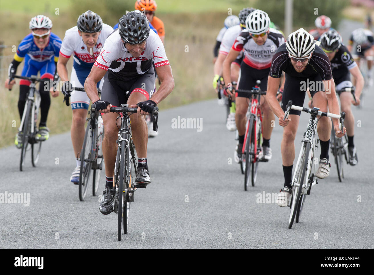 Professional cyclists sprinting for the line in the 'Tour of the Mining Valleys' cycle race Ceredigion Wales - Stock Image