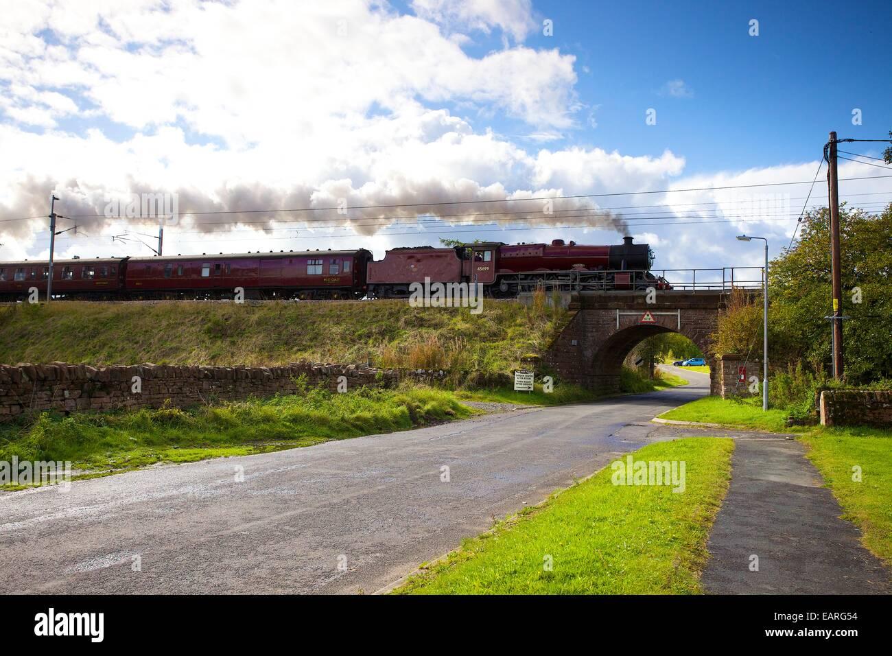 Steam locomotive LMS Jubilee Class 45699 Galatea at Plumpton, Cumbria, England, UK. Stock Photo