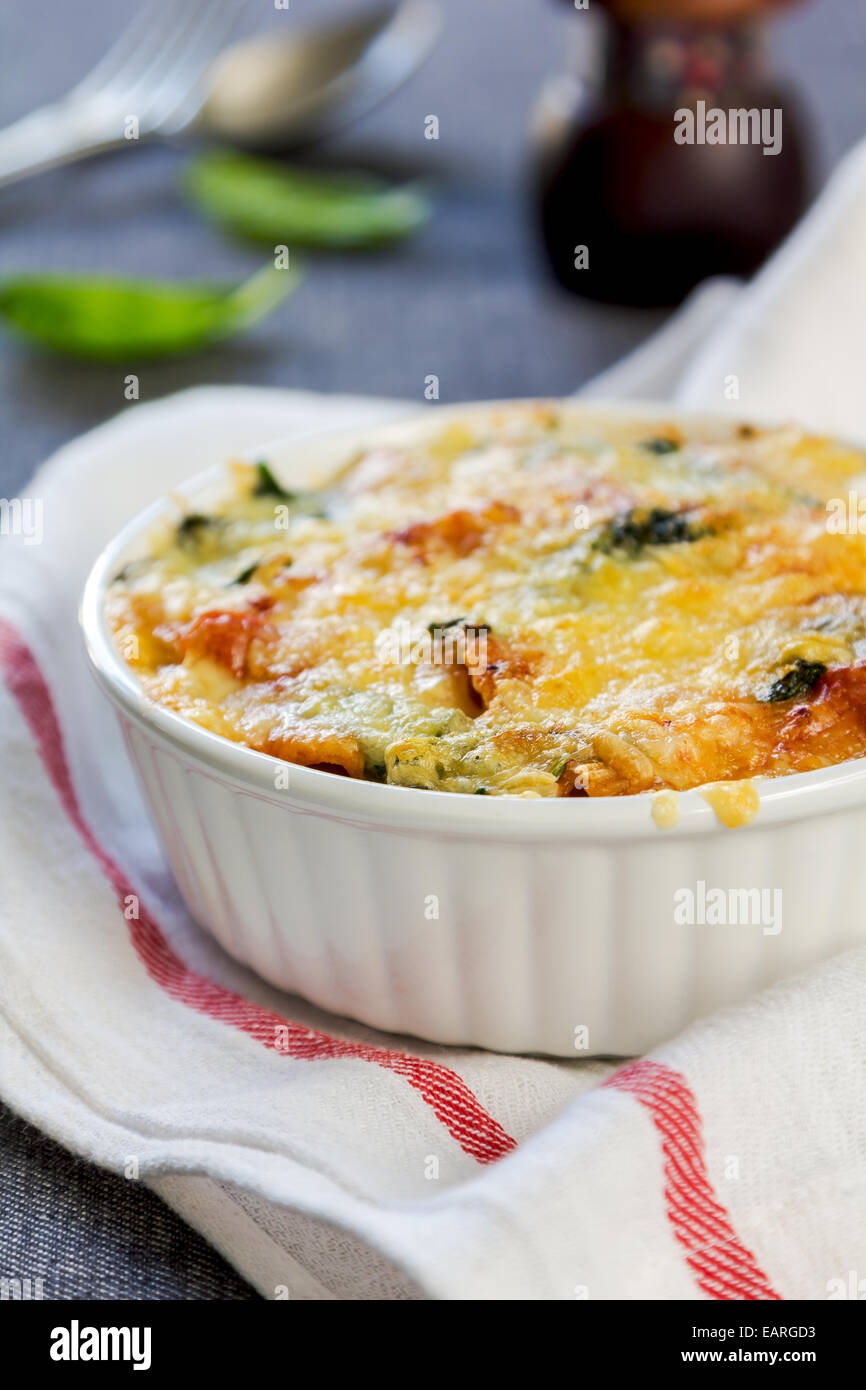Baked Rigatoni with spinach in tomato sauce - Stock Image