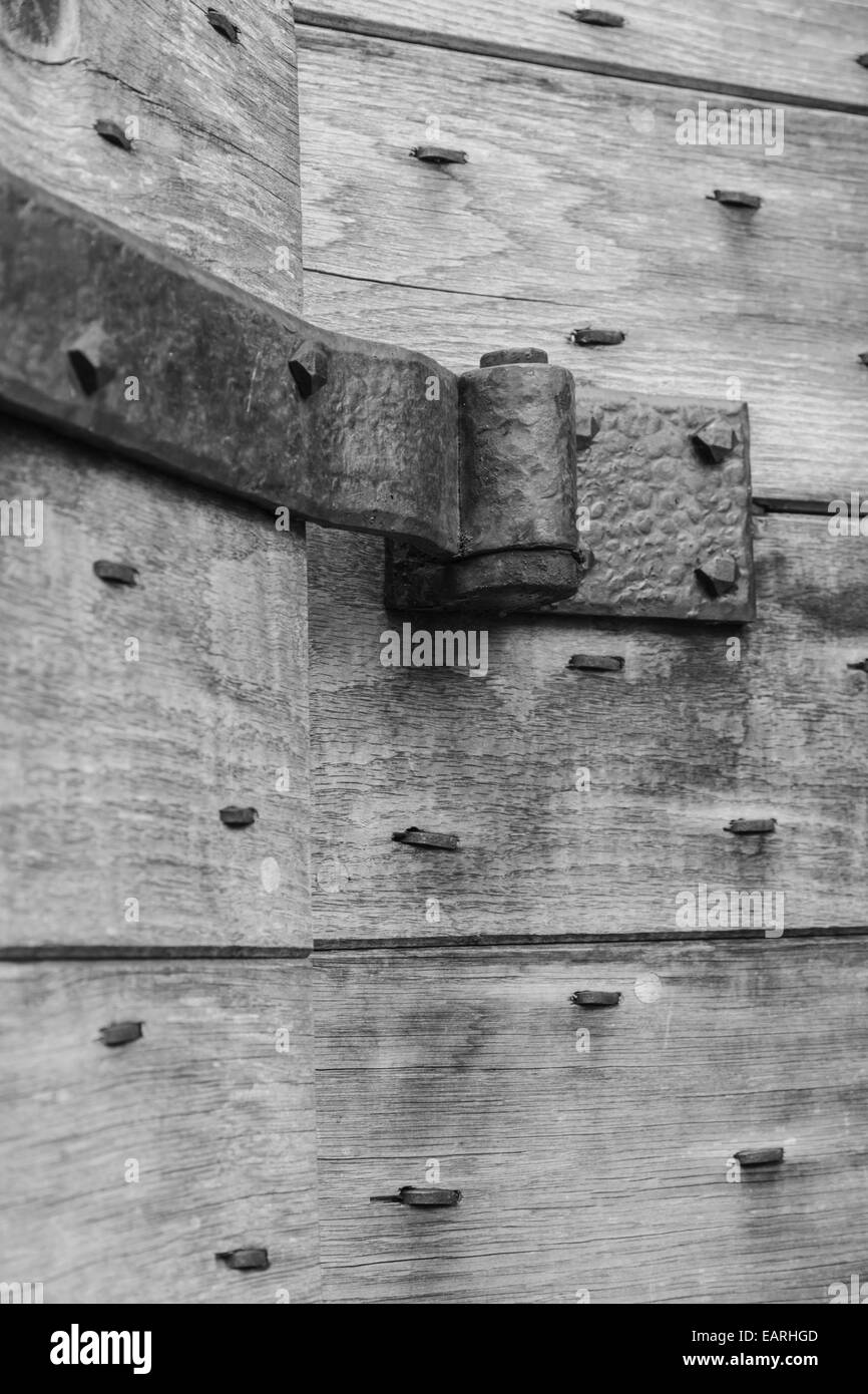 Steel strap hinge supporting a solid oak door. - Stock Image