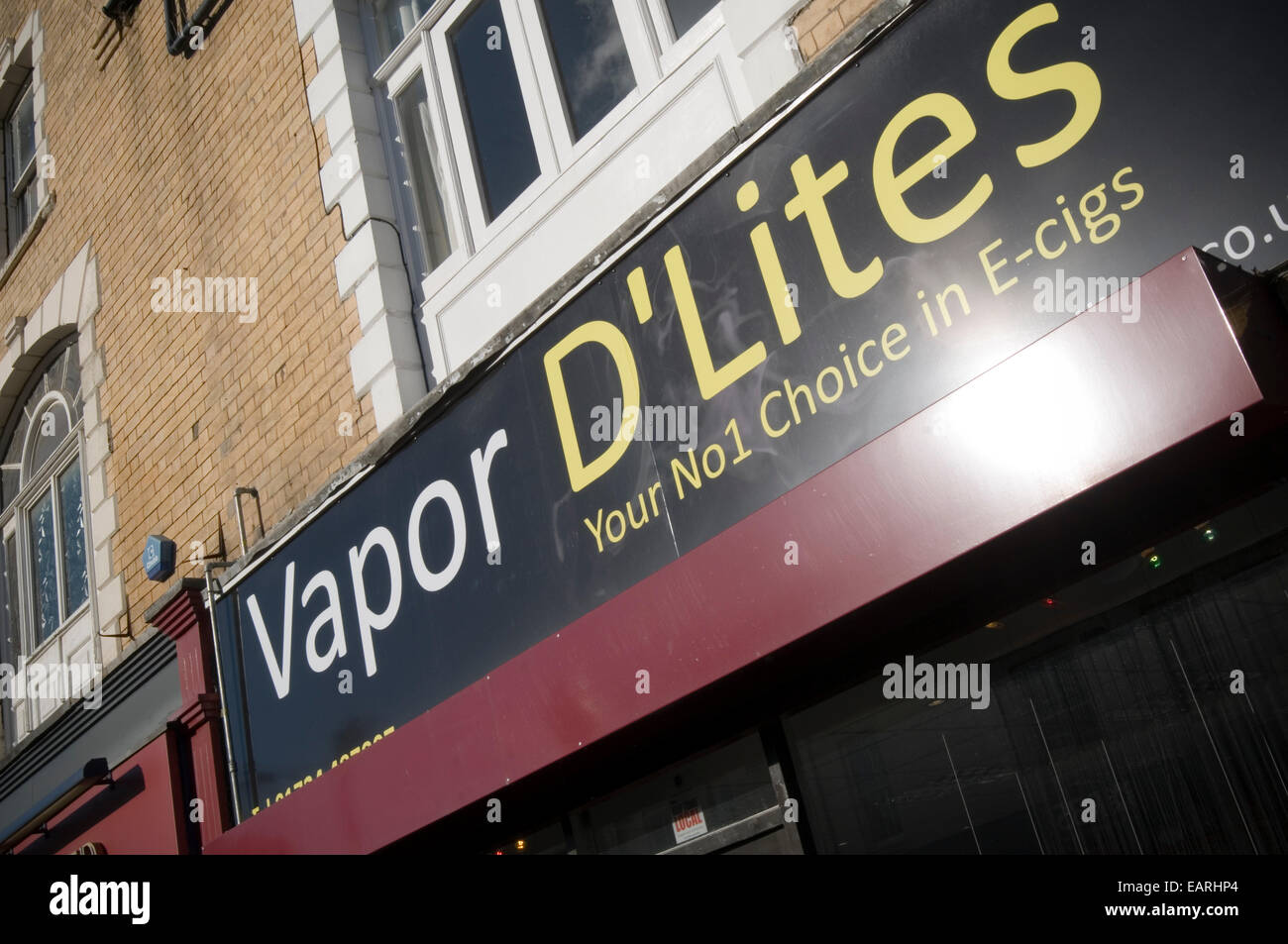 e cigarette cigarettes shop shops vaping vapor smoke smoking - Stock Image
