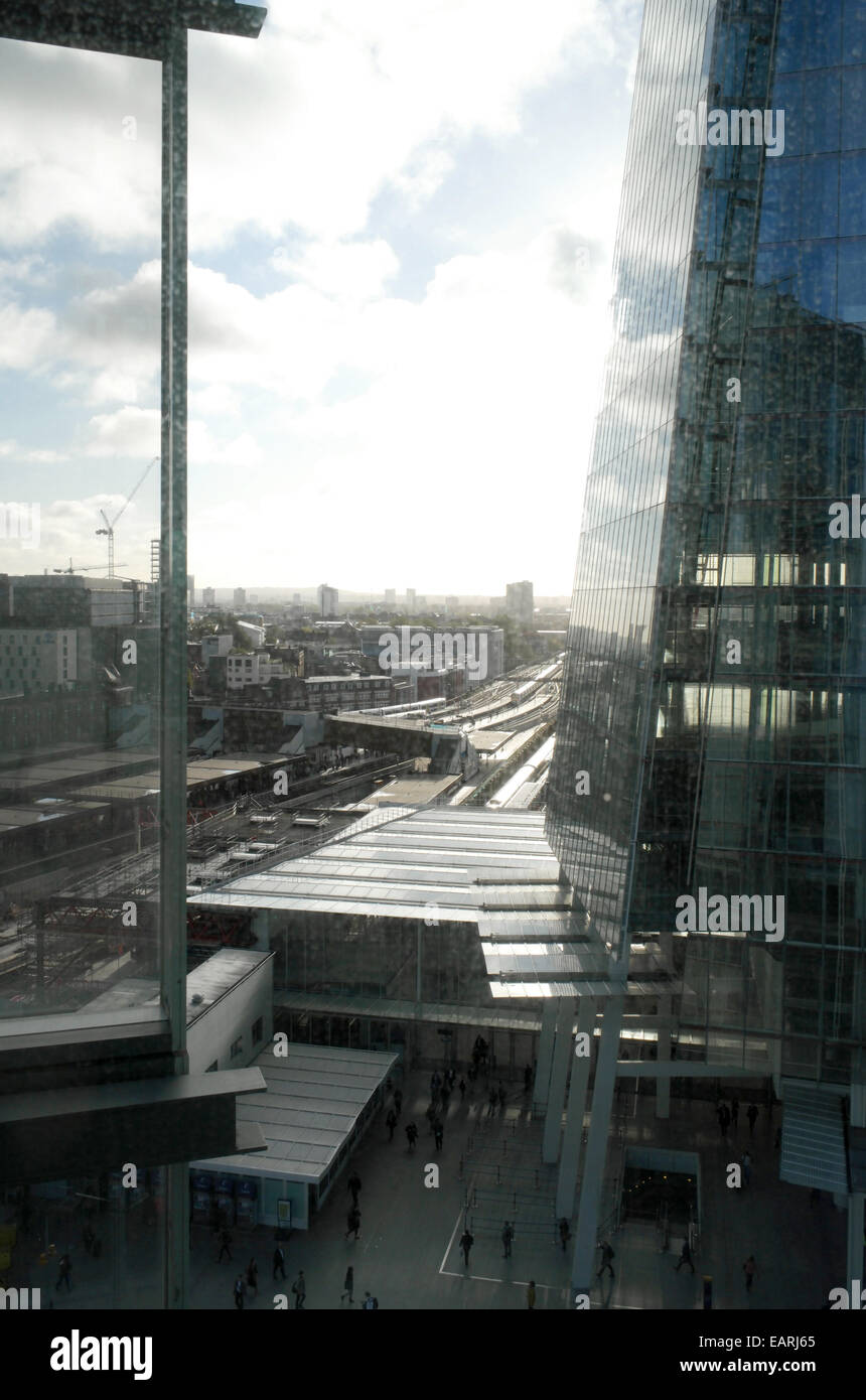 London Bridge station entrance and railway lines and the Shard - Stock Image