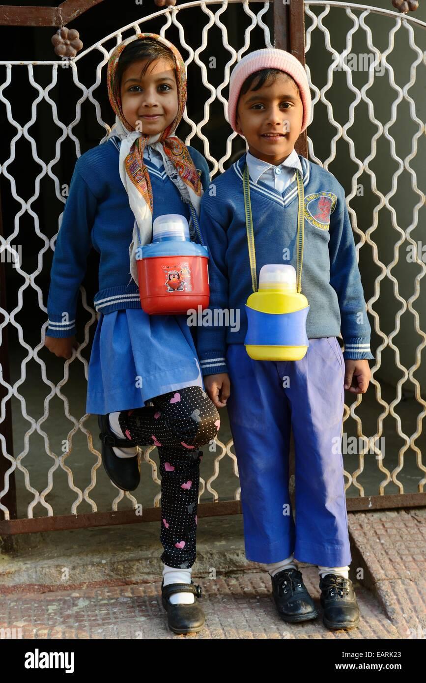 India, Rajasthan, Mewar Region, town of Bundi, schoolchildren almost from school - Stock Image