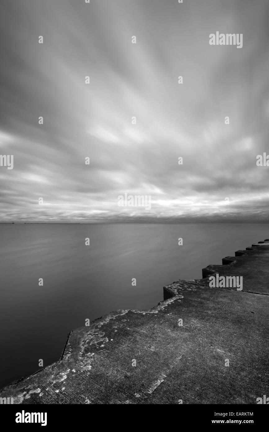 Lake With Blurry Clouds & Pier - Stock Image