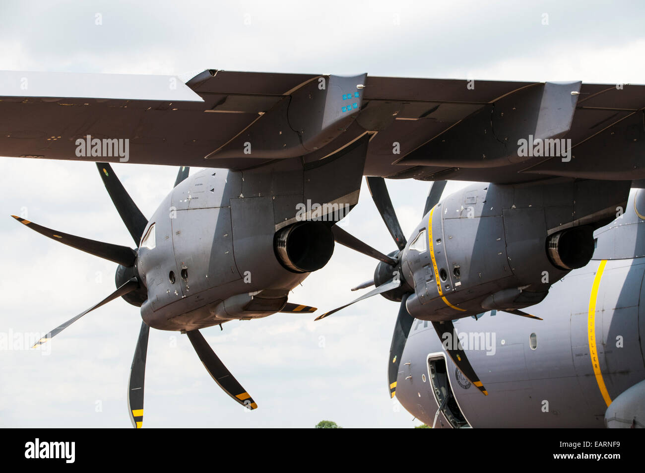 View of the huge turboprop engines from under the wing of an Airbus A400M transport plane - Stock Image