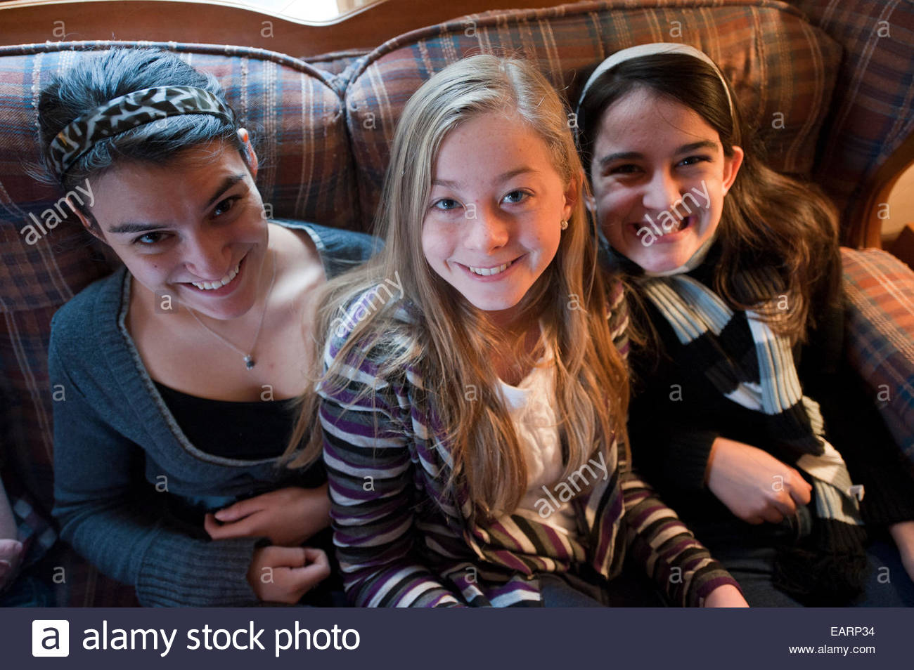 Cousins spend time together over the holidays. - Stock Image