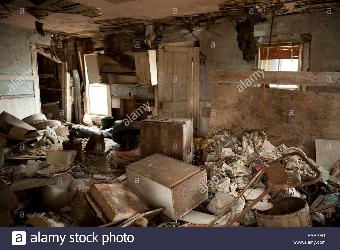 An abandoned house filled with junk. - Stock Image