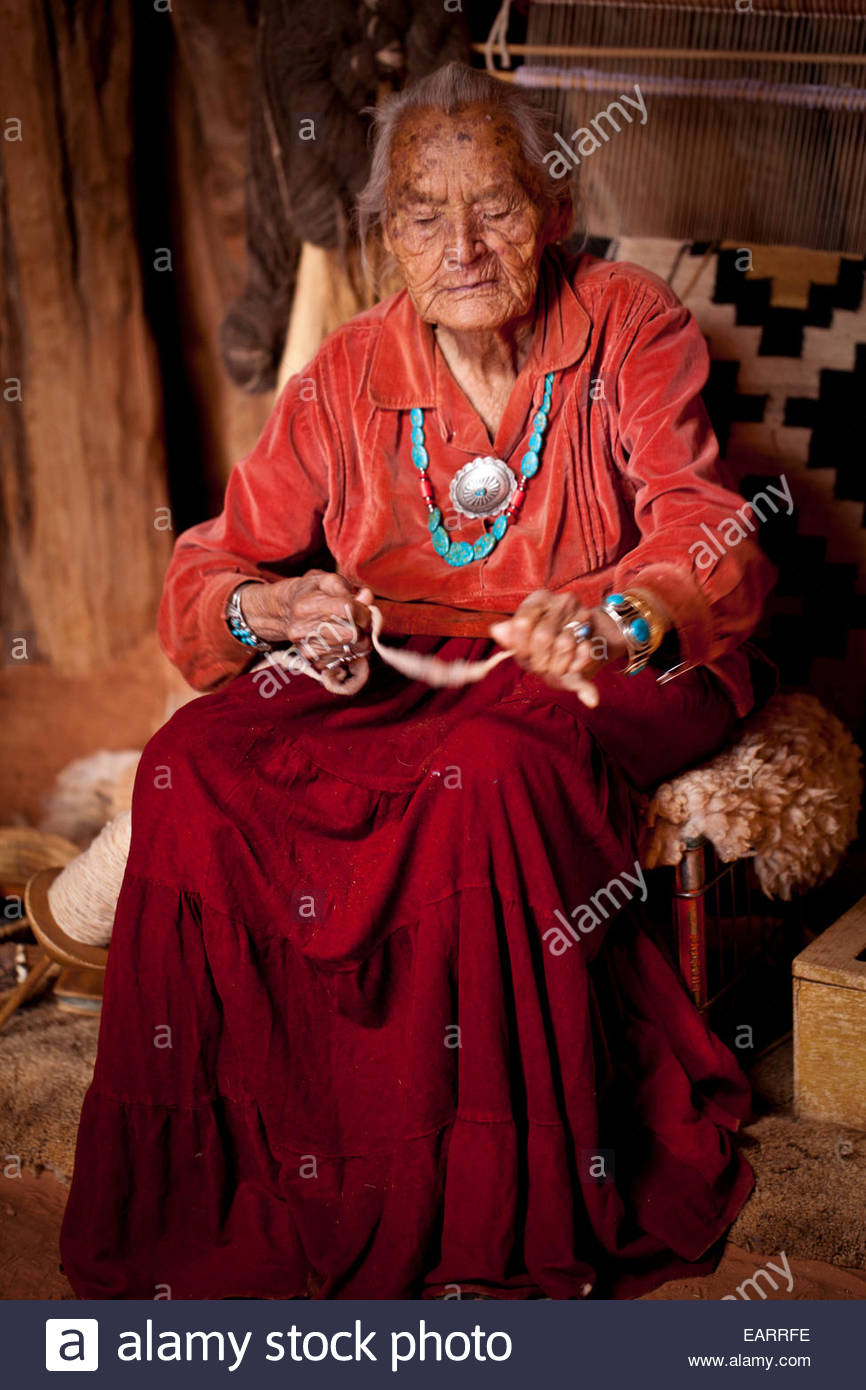Old Navajo weaver, said to be over 100 years old still working in her hogan. - Stock Image