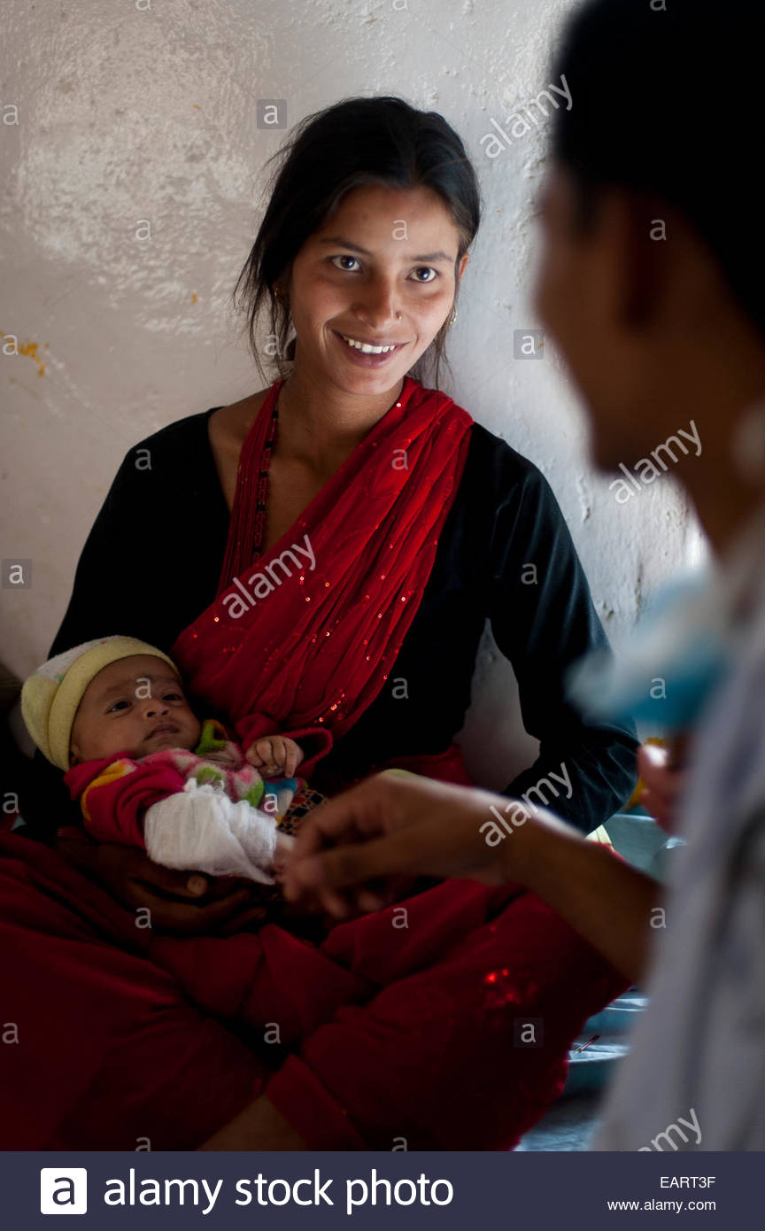 A doctor talks to a patient in a rural hospital in Nepal. - Stock Image