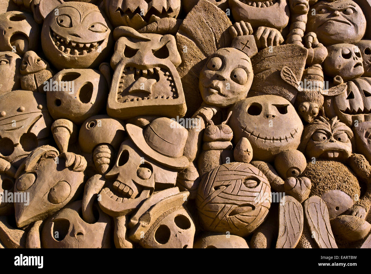 Tim Burton inspired sand sculpture, 'A Closer Look' features death faces. - Stock Image