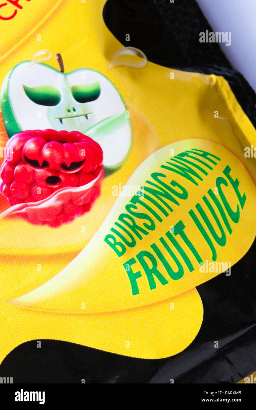 Bursting with fruit juice - detail on bag of Starburst fruit chews scare edition trick or treat - Stock Image