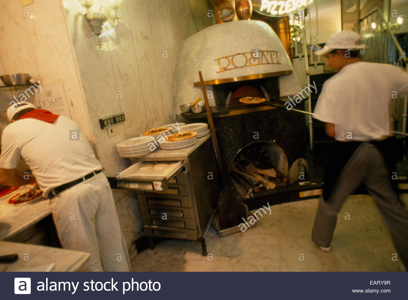 A skilled pizzaiolo working at Brandi, one of the city's pizzerias. - Stock Image