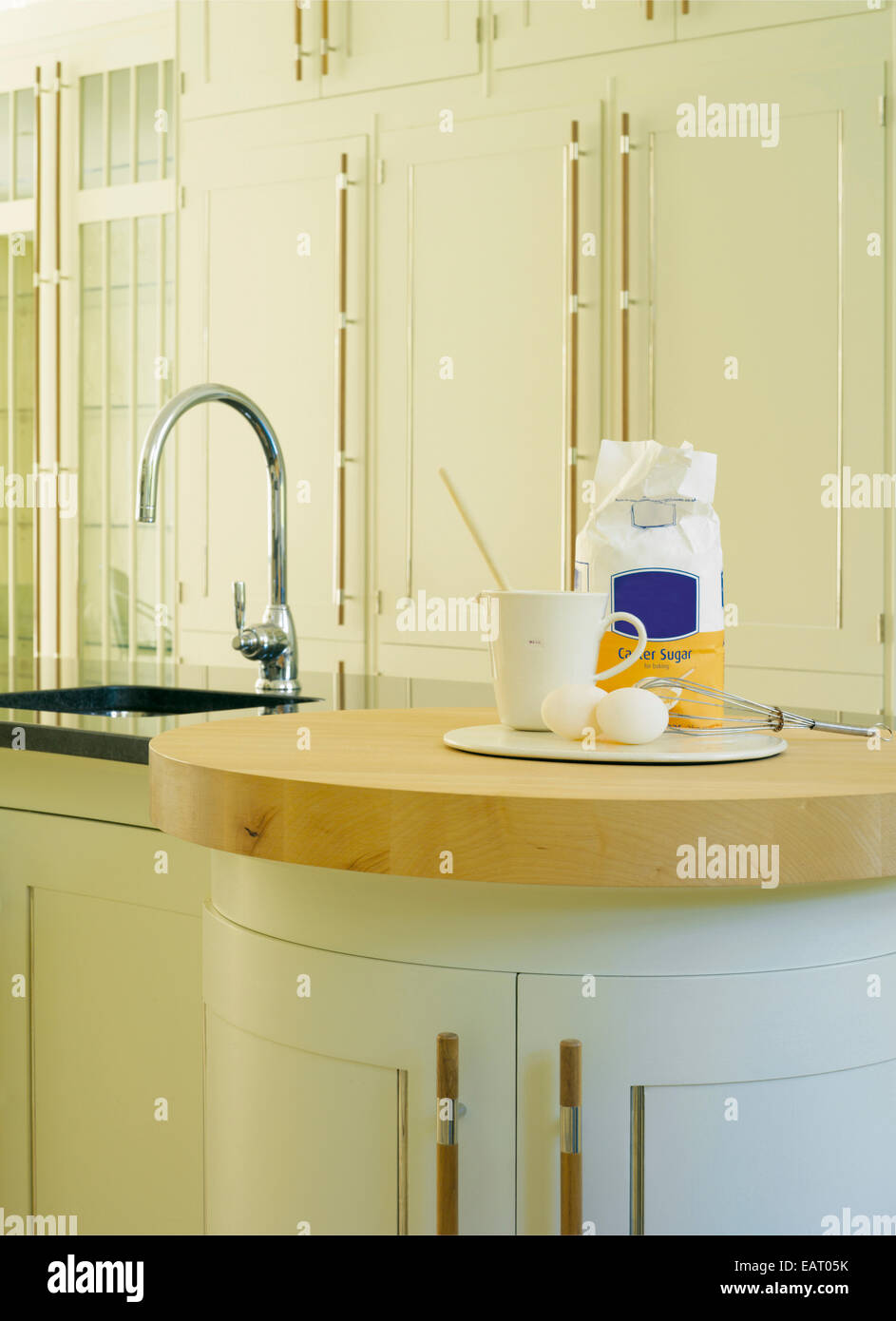 Cooking ingredients on wooden worktop in contemporary kitchen Stock Photo