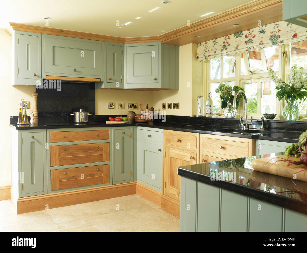 country style kitchen with green fitted units stock image - Country Style Kitchen