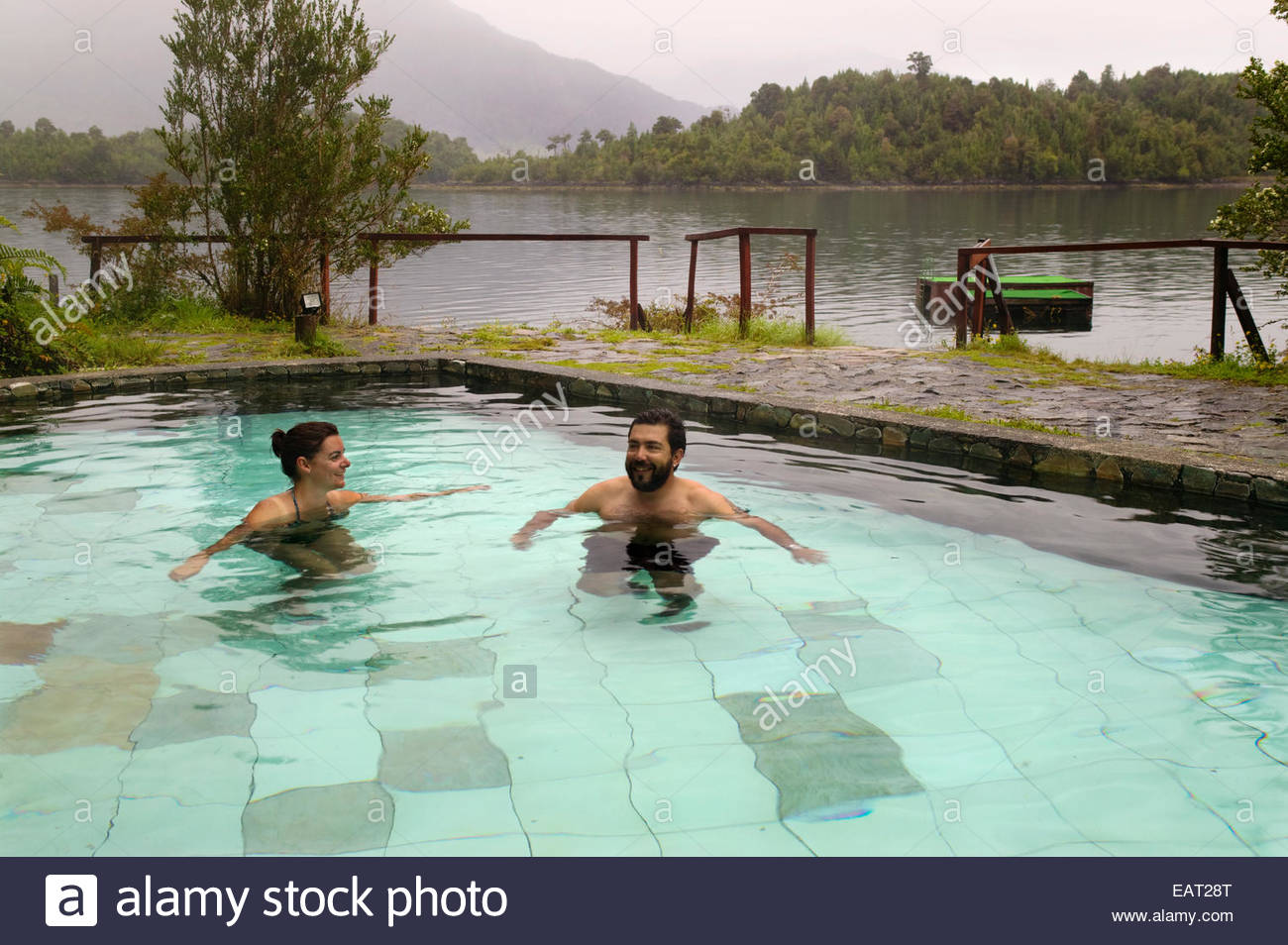 Relaxing in a natural hot spring, in Puyuhuapi, Patagonia, Chile. - Stock Image
