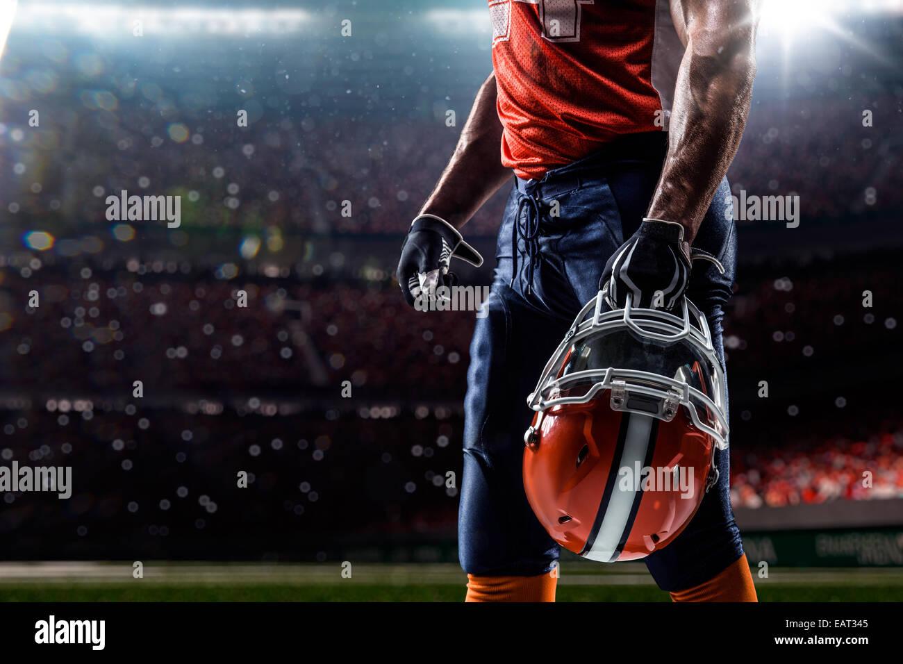 American football sportsman player in olympic stadium - Stock Image